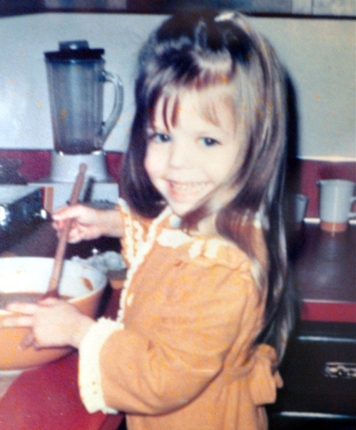 young Kristina Sloggett in kitchen