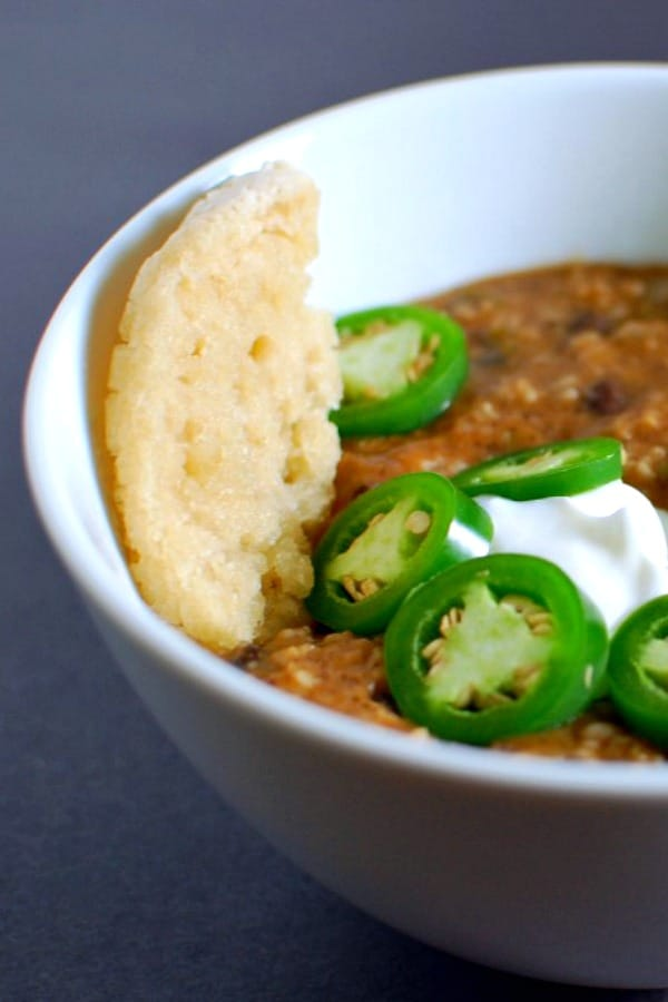 Jalapeno Black Bean Soup in a bowl with a slice of bread