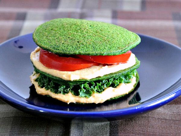 Spinach Pancake sandwich with hummus, kale, and tomto