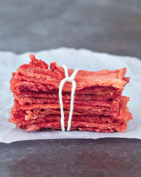 Watermelon Candy strips in a stack, tied with twine