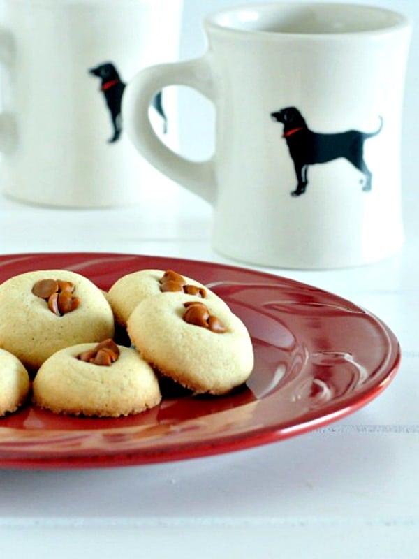 Irish Cream Cookies on a plate with mugs of coffee