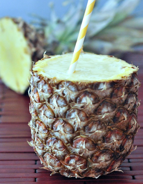 vegan Lightened Up Pina Coladas served in a pineapple