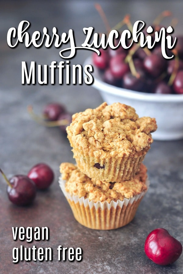 cherry zucchini muffins with a bowl of fresh cherries in background