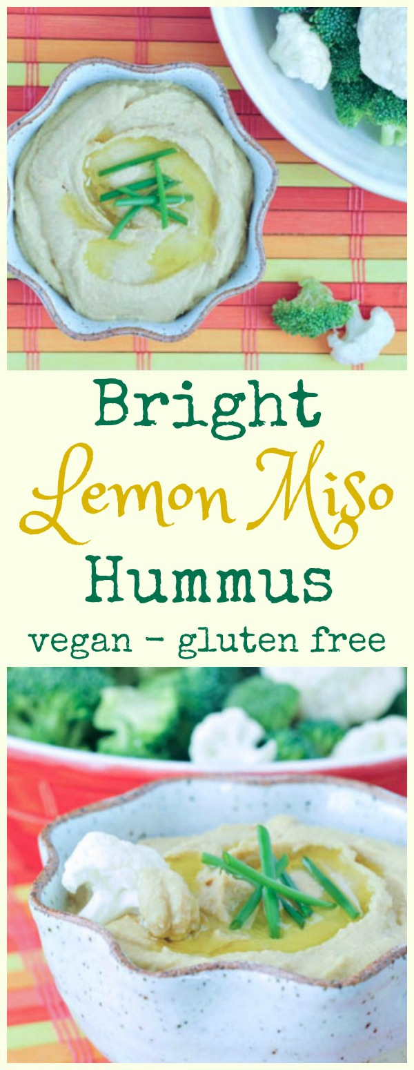 Bright Lemon Miso Hummus in a bowl with broccoli and cauliflower for dipping