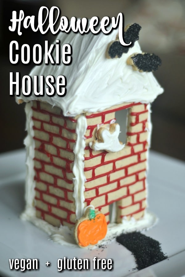 a Halloween themed cookie house, including bat, ghost, and pumpkin shaped cookies