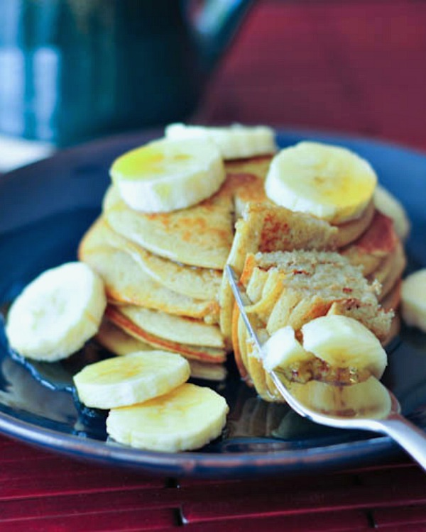 stack of Banana Maca Pancakes with sliced bananas and syrup