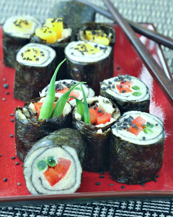 Ginger Cashew Nori Rolls served on plate with chopsticks
