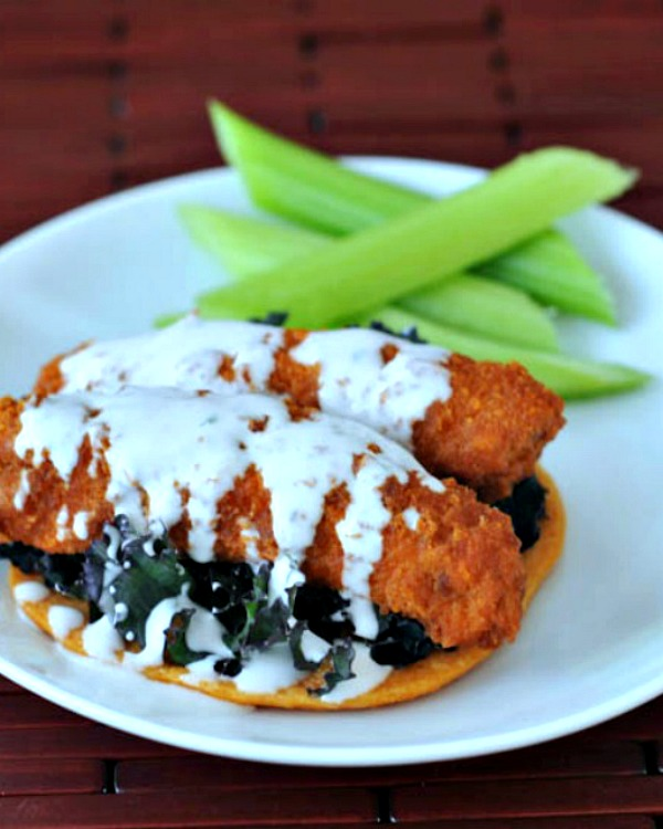 """buffalo """"chicken"""" wings on plate with ranch dressing and celery sticks"""