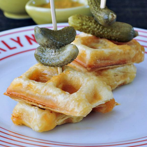 Croque Monsieur Stuffed Waffles stacked in a bite size skewer with a pickle
