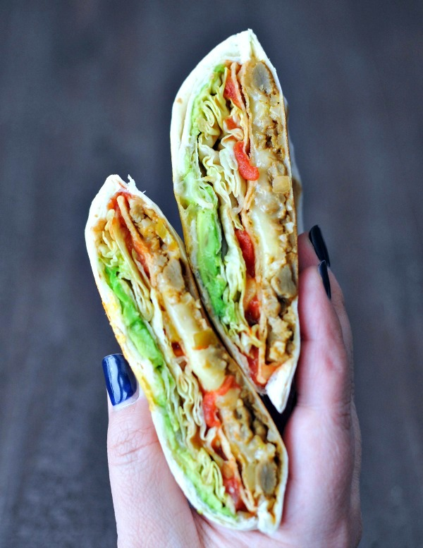 are crunchwraps vegan? photo shows a vegan crunchwrap held in a hand