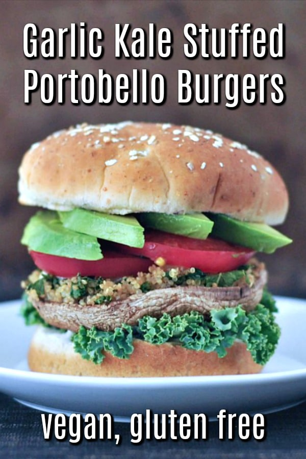 Garlic Kale Stuffed Portobello Burgers on a bun with avocado and tomato