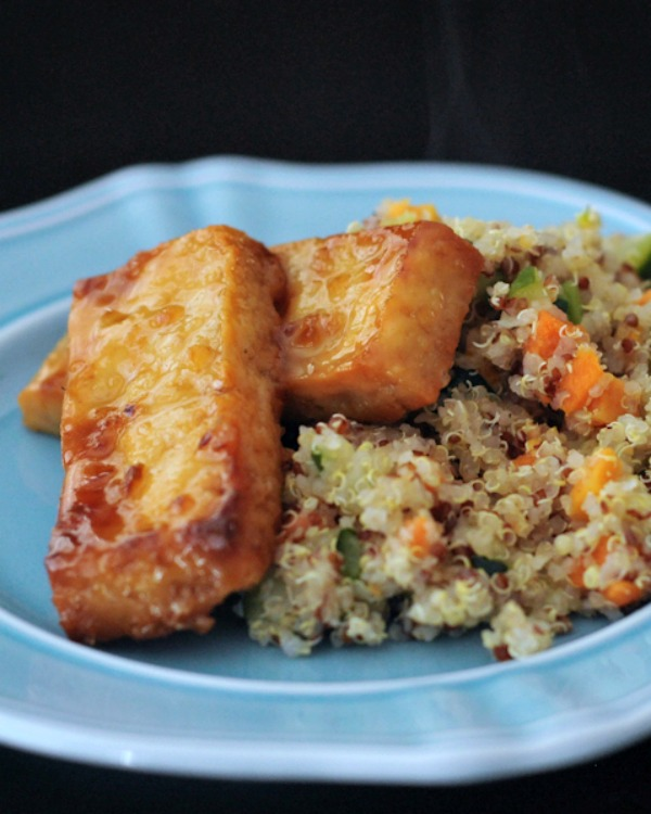 tofu slabs coated with sticky whiskey garlic sauce, fried in air fryer, served over vegetable quinoa