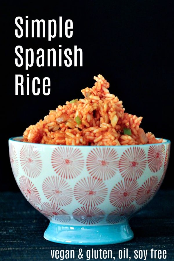 a bowl of Spanish rice: tomato red rice with chopped onions and green peppers