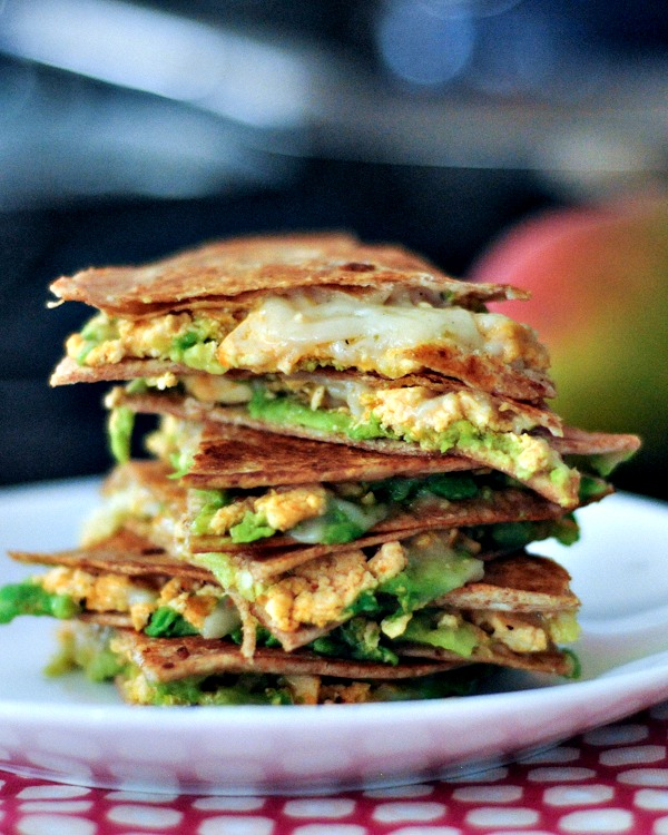 Chipotle Quesadilla triangles stacked high on a plate