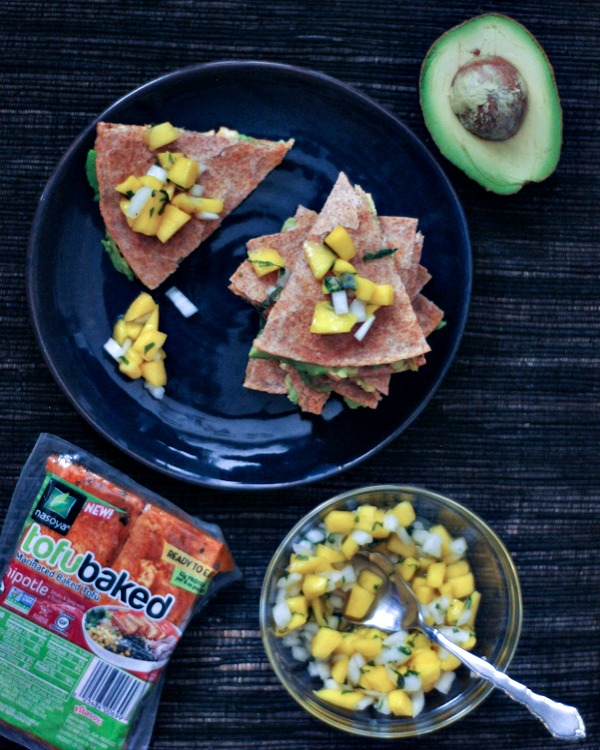 Chipotle Quesadillas on a plate, sliced avocado and bowl of Minty Mango Salsa on the side,