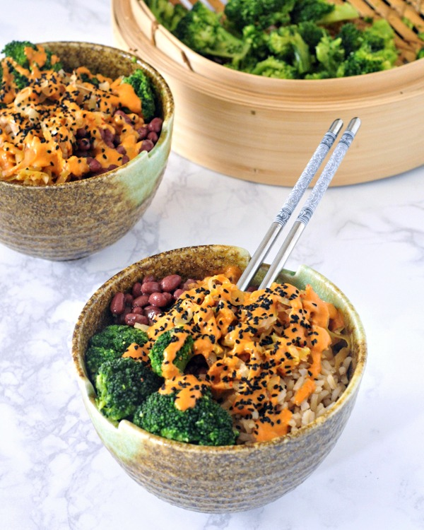 two Kimchi Bowls with Red Curry Almond Sauce, broccoli in steamer on the side