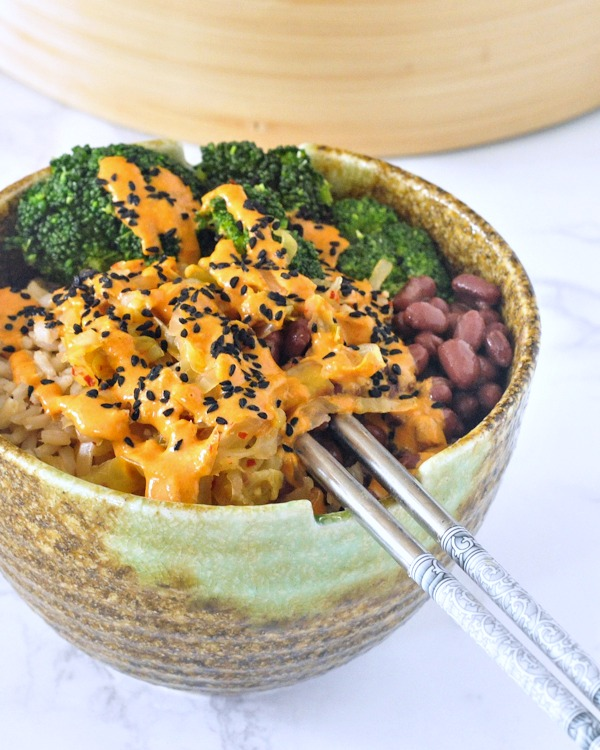 single Kimchi Bowl with Red Curry Almond Sauce with chopsticks