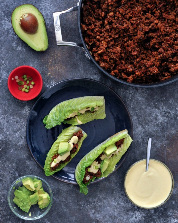 "Spicy Vegan Chorizo Sausage Crumbles in skillet and on plate with romaine leaf ""taco shells"""