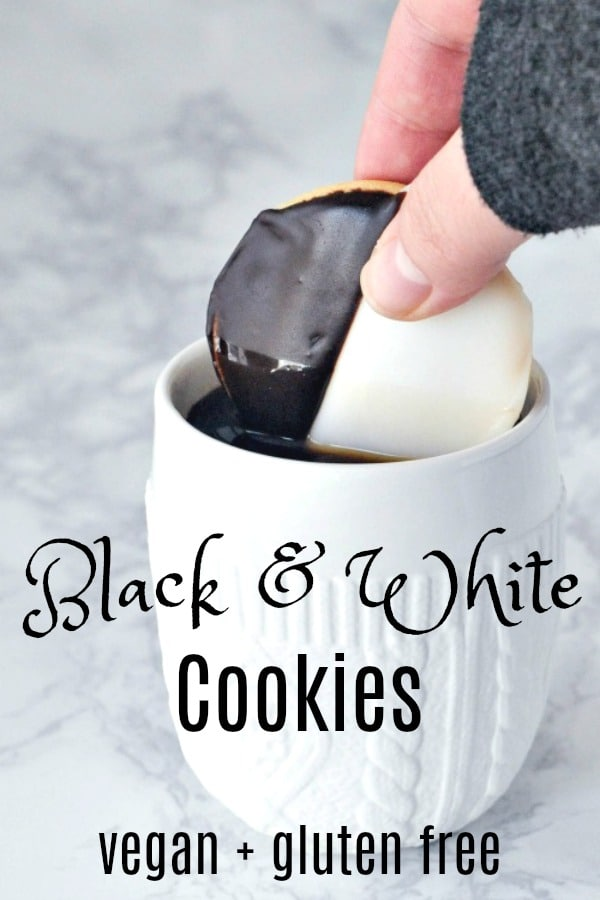 Black and White Cookie dunked into a white mug of black coffee