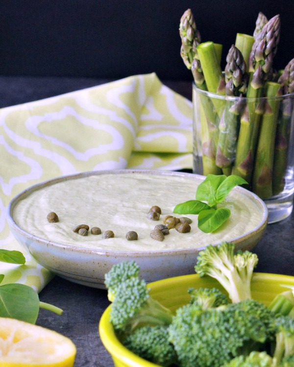 Green Goodness Dressing Dip in a bowl, served with asparagus and broccoli for dipping