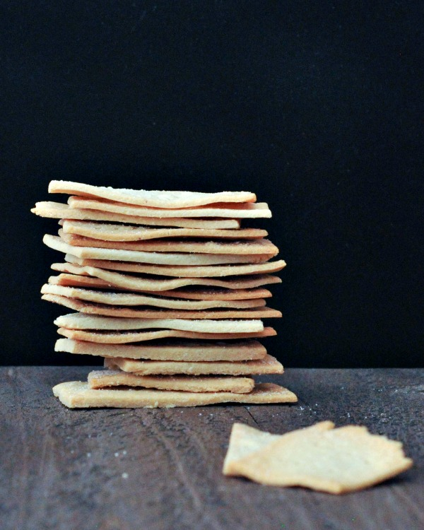stack of Salt and Vinegar Crackers against black background
