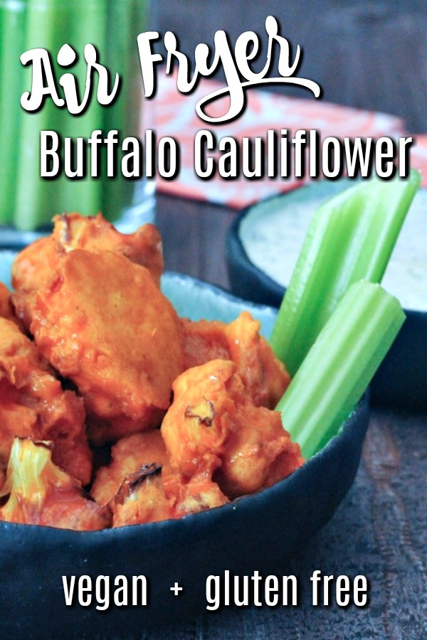 Air Fryer Buffalo Cauliflower in a low bowl with celery slices and ranch dipping sauce