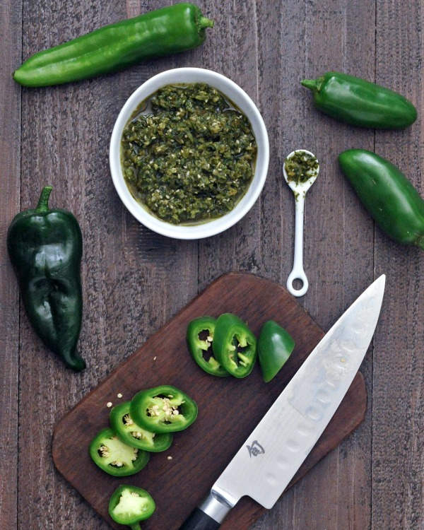 Spicy Jalapeño Sesame Salsa in a bowl, fresh peppers and knife aside