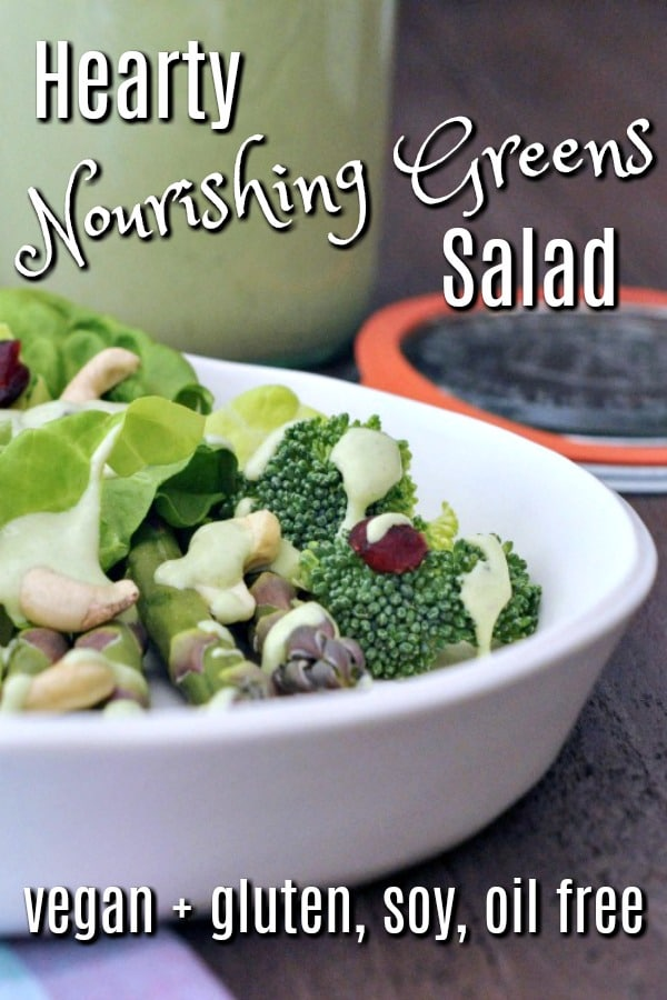 Hearty Nourishing Greens Salad: broccoli, butter lettuce, asparagus, cashews, cranberries served in a white bowl
