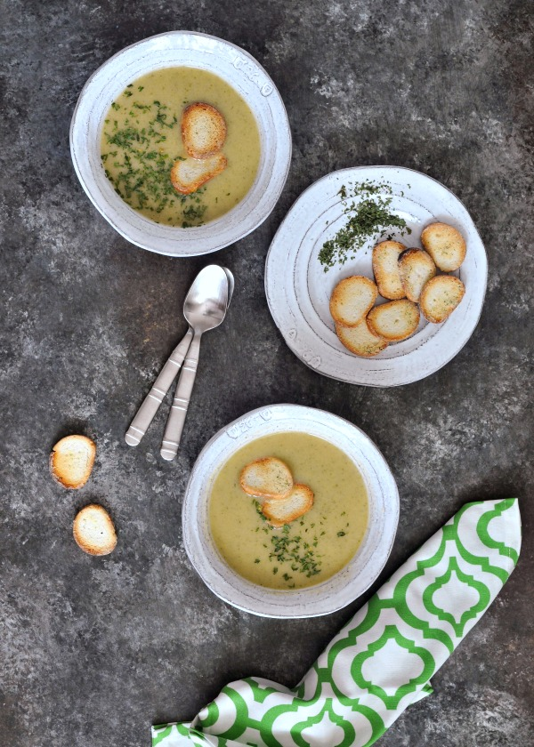 Easy One Pot Artichoke Soup in bowls with bagel chip garnish