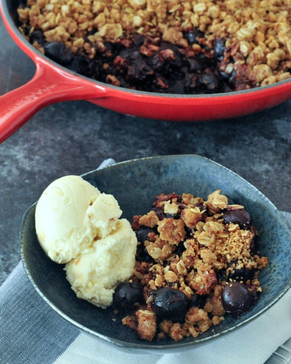 chocolate and cherry crisp in bowl with ice cream
