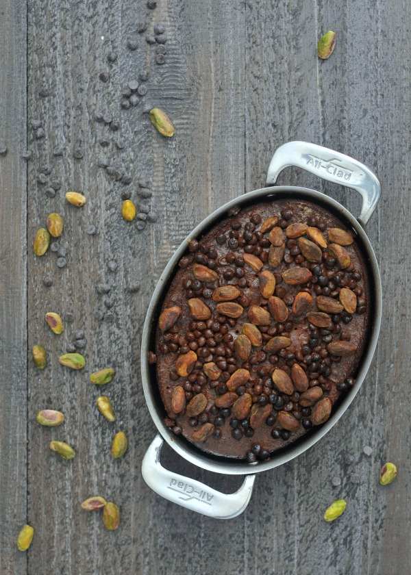pan of Salty Pistachio Small Batch Brownies, pistachios and chocolate chips scattered around