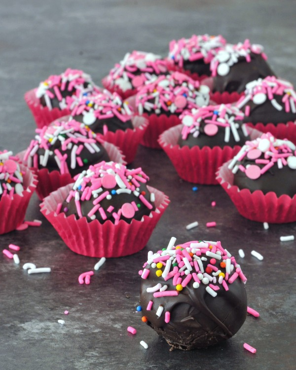 Chocolate Covered Oreo Cashew Truffles in cupcake liner cups