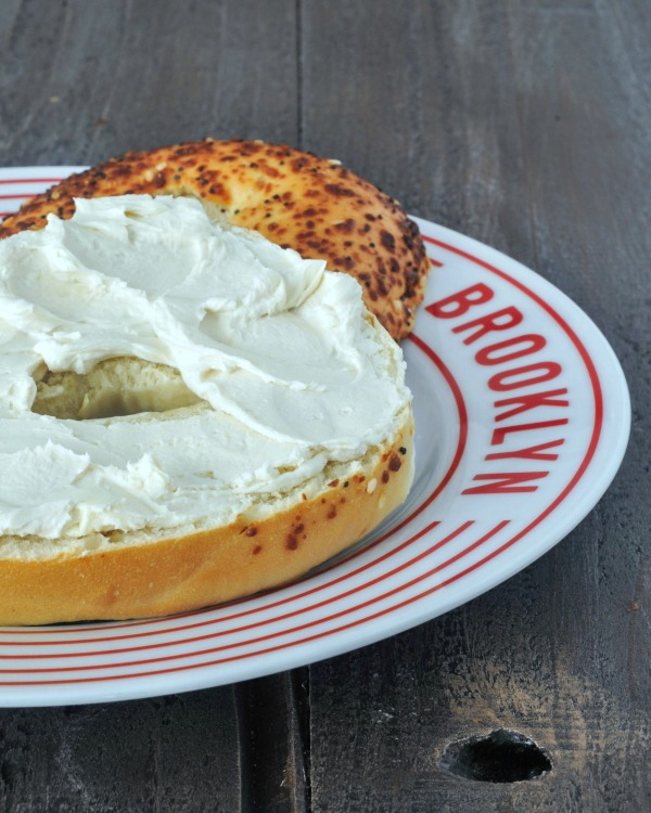 Creamy Rich Macadamia Cream Cheese spread on a bagel