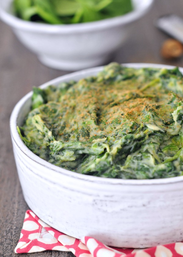 large serving bowl of Rich Cauliflower Creamed Spinach