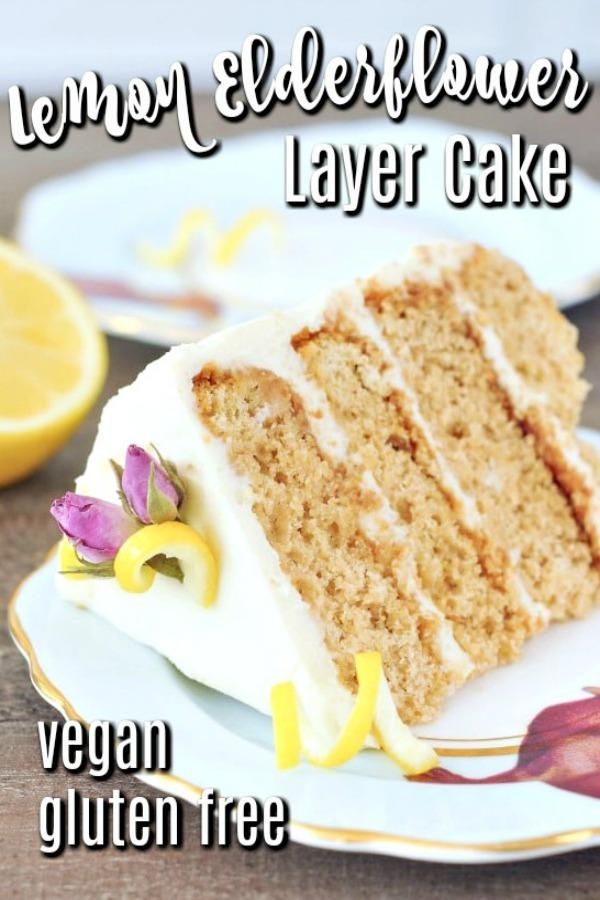 slice of Lemon Elderflower Cake with white frosting on a tea saucer, slice of lemon in background