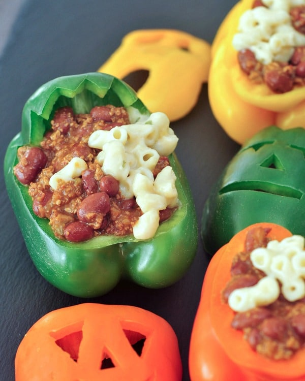 Chili Mac Halloween Stuffed Peppers: a green bell pepper carved into Frankenstein monster face and filled with chili mac