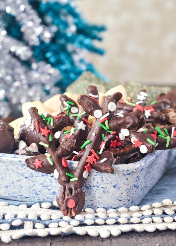 Chocolate Covered Pretzel Reindeer in a holiday cookie tray