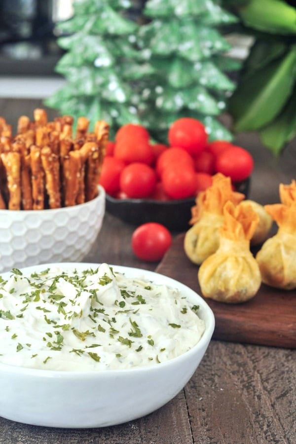 Garlic Herb Vegan Cheese Spread alongside other appetizers and veggie dippers