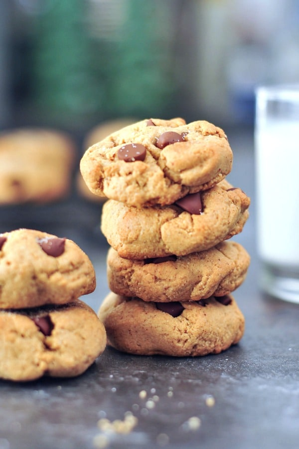 small stack of Flourless Chocolate Chip Cookies next to a glass of milk