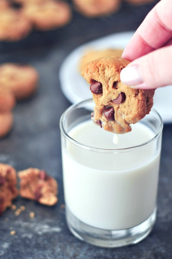 Grain Free Chocolate Chip Cookie dipped into a glass of milk
