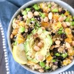 Mango Black Bean Salad in a bowl with squeezed lemon and cubed avocado