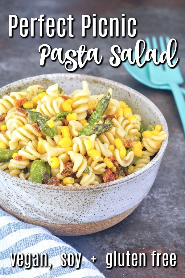 Perfect Picnic Pasta Salad (serving bowl of cooked corkscrew pasta, fresh grilled corn kernels, sliced roasted asparagus, sundried tomatoes)