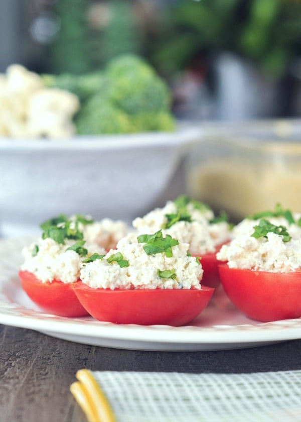 Vegan Stuffed Tomatoes - Roma tomato halves filled with ricotta cheese, topped with fresh basil