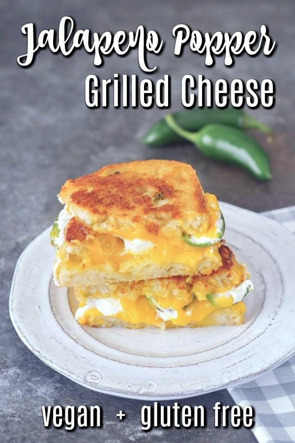 Jalapeno Popper Grilled Cheese on a white plate, with a checkered napkin and fresh jalapeno peppers in background