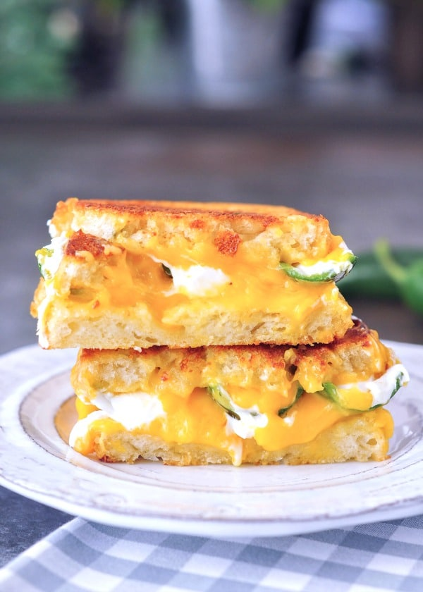 Jalapeno Popper Sandwich, sliced in half and stacked high on a plate