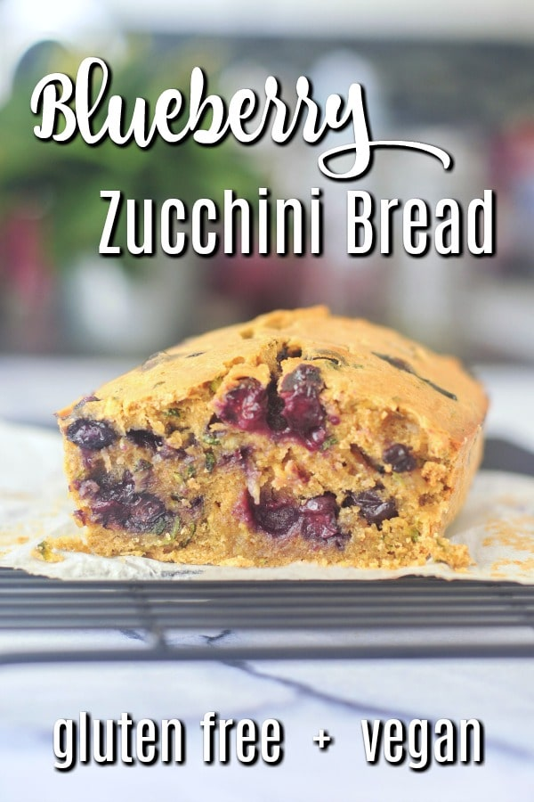 loaf of Vegan Blueberry Zucchini Bread on a wire cooling rack