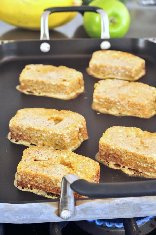 How To Make Vegan French Toast - six slices grilling on a griddle