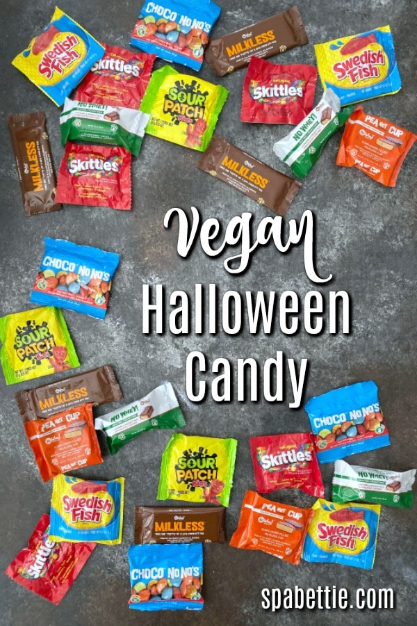 an assortment of Vegan Halloween Candy: Swedish Fish, Skittles, Sour Patch, PeaNOT Cups, Milkless Bar, Chocolates