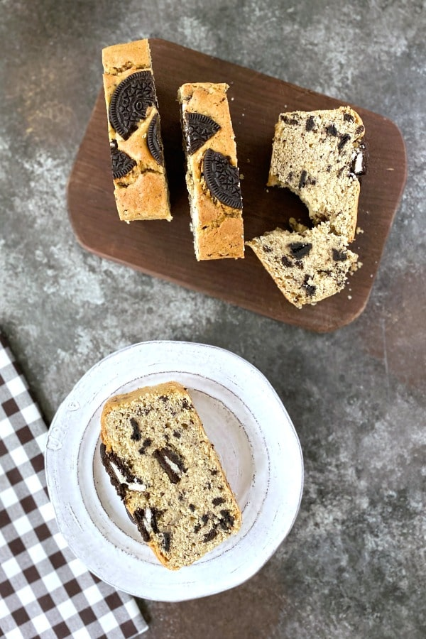 overhead view of Cookies and Cream Pound Cake: a slice on a plate, several slices on a cutting board