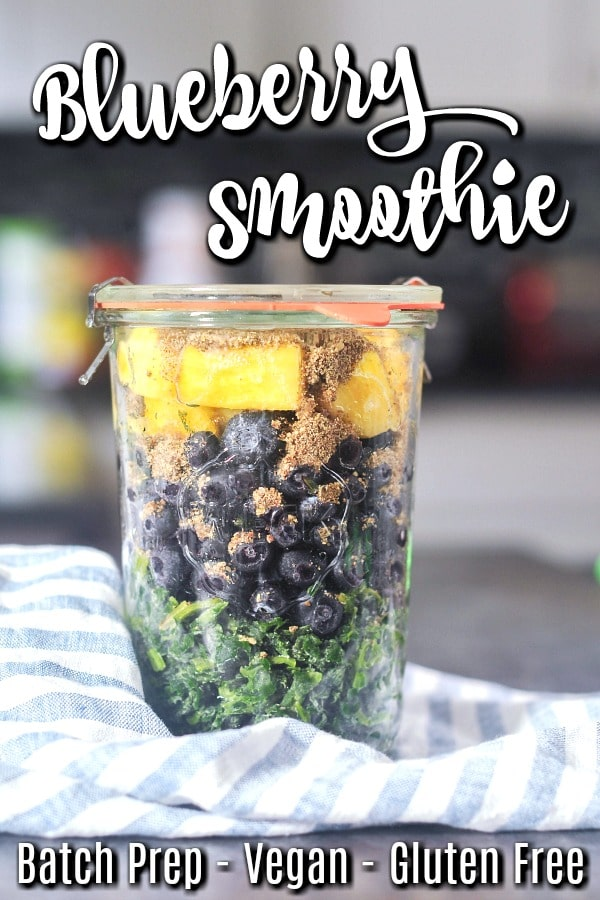 a glass jar filled with frozen spinach, fruit, hemp and flax seeds: meal prep smoothies